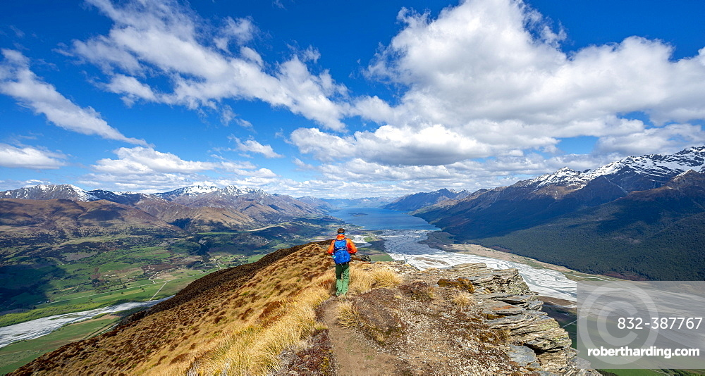 Hiker on the summit of Mount Alfred, views of Lake Wakatipu and mountain scenery, Glenorchy near Queenstown, Southern Alps, Otago, South Island, New Zealand, Oceania