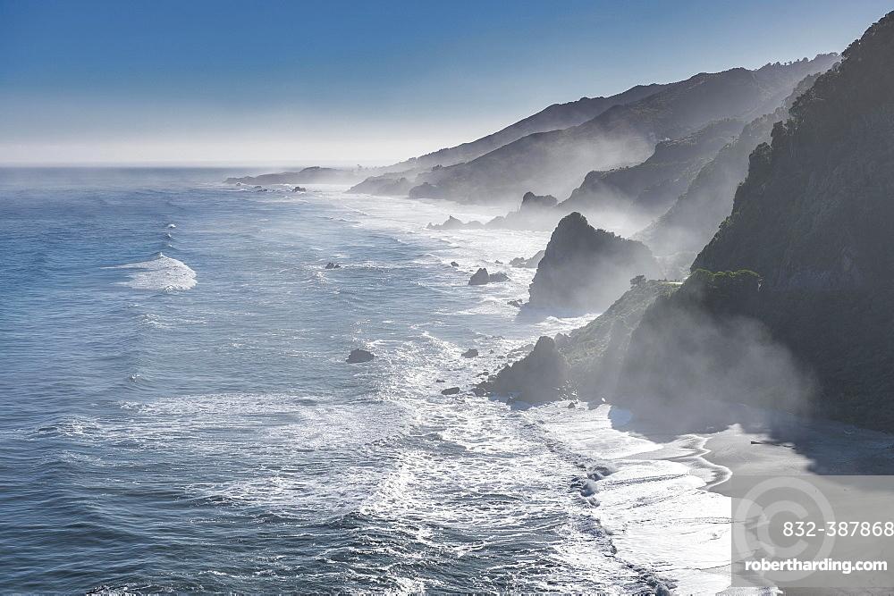View from the coastal road, unspoiled rocky coast with sea spray, West Coast, Punakaiki, West Coast Region, New Zealand, Oceania