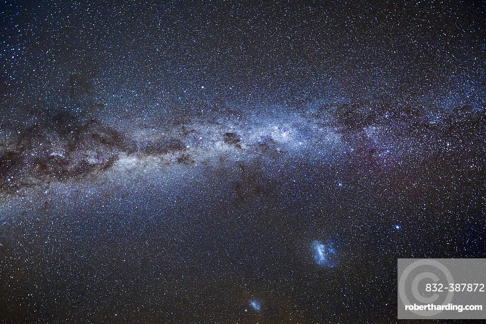 Milky Way with the two Magellanic Clouds in the New Zealand night sky, West Coast, New Zealand, Oceania