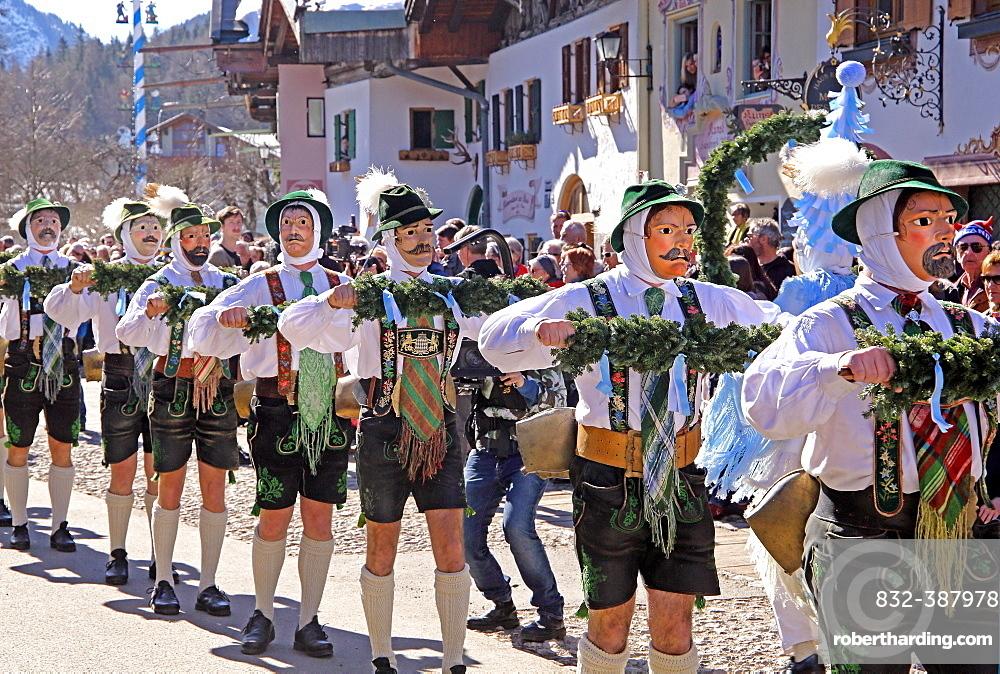 Bell stirrer in the Maschkera procession at carnival, Mittenwald, Werdenfelser Land, Upper Bavaria, Bavaria, Germany, Europe