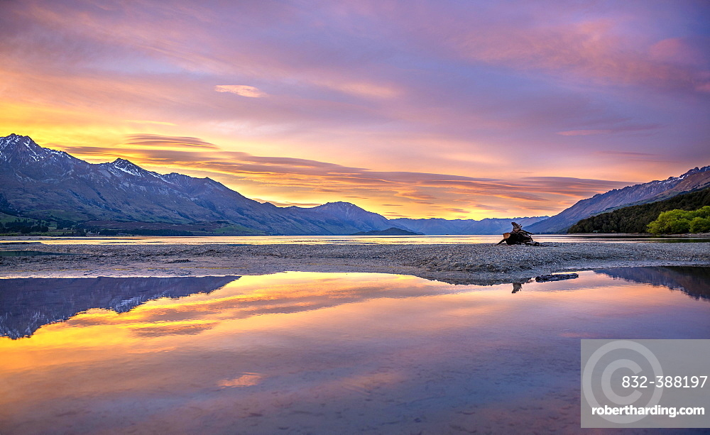 Mountains reflected in the lake, Lake Wakatipu at sunrise, Kinloch, Glenorchy near Queenstown, Otago, South Island, New Zealand, Oceania
