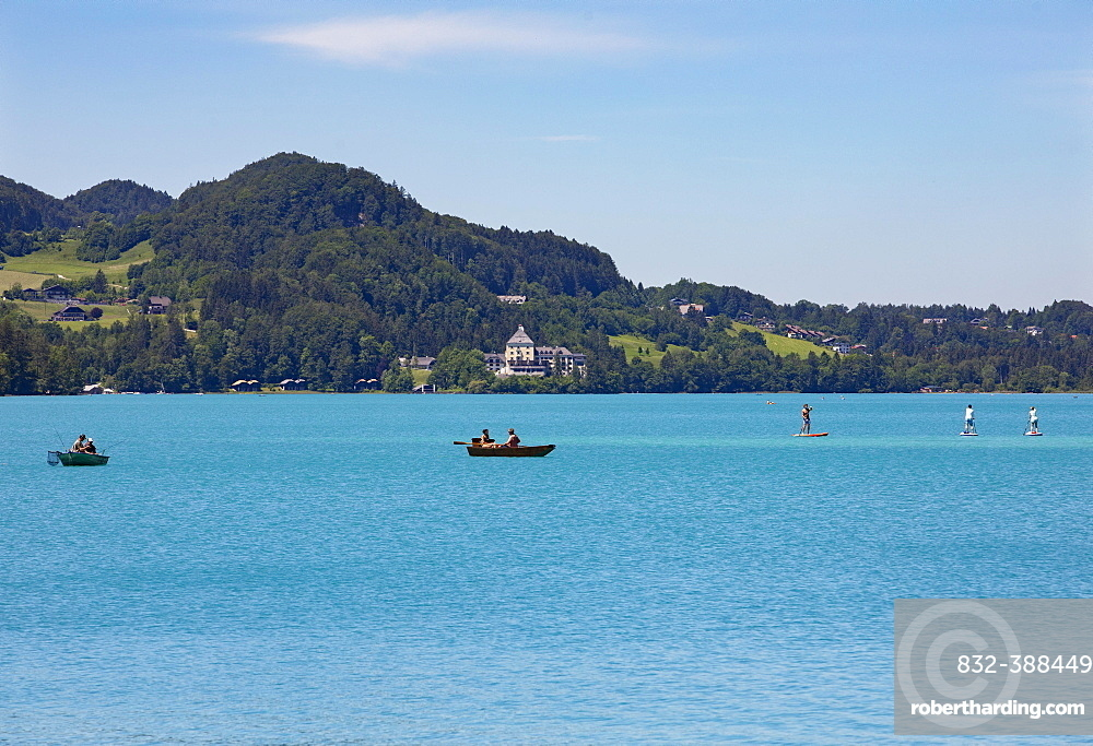 Boats at the Fuschlsee with castle Fuschl,,Fuschl am See, Salzkammergut, Country Salzburg, Austria, Europe