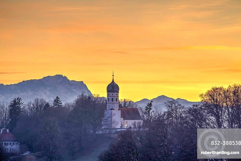Church St. Johann Baptist at sunset, in the back Zugspitze, Holzhausen, Starnberger See, Bavaria, Germany, Europe