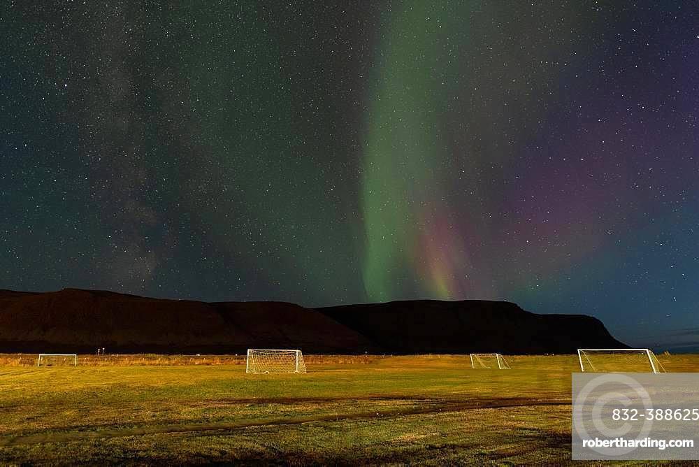 Northern Lights above the football field of the village of Talknafjoerour, Talknafjoerour, Westfjords, Northwest Iceland, Iceland, Europe