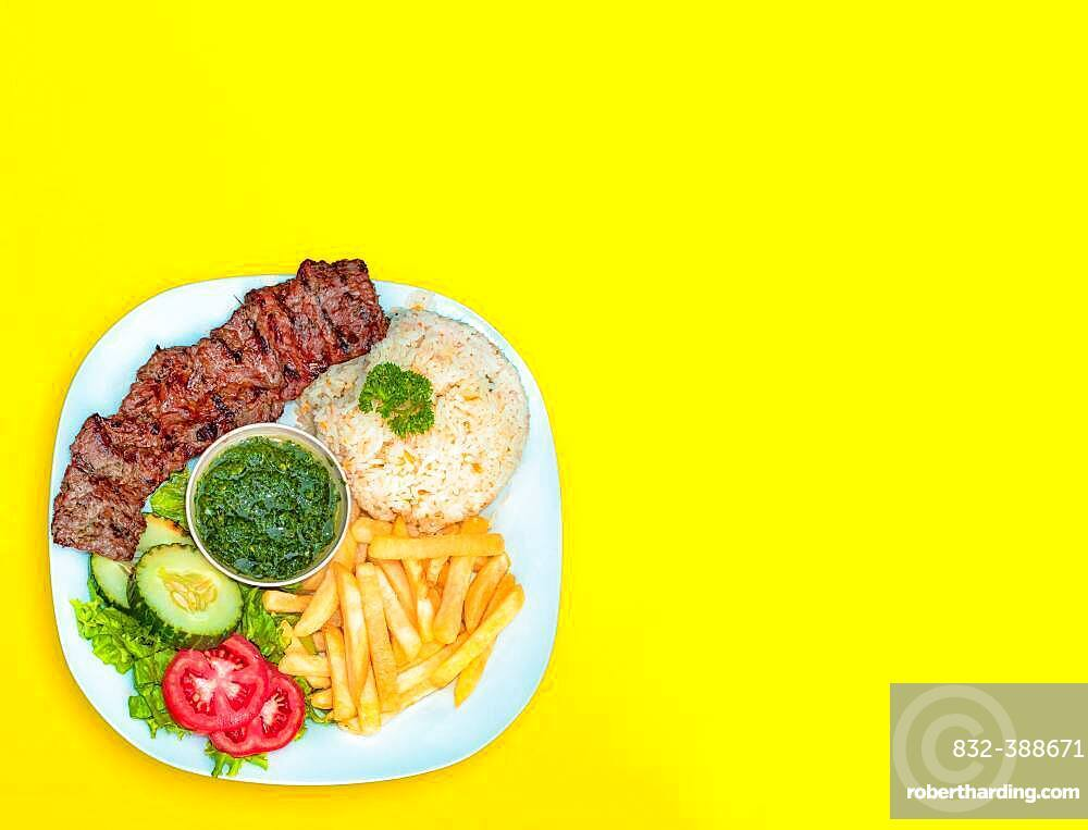 Lunch with cheese, roast beef and french fries, food plate with chalkboard background