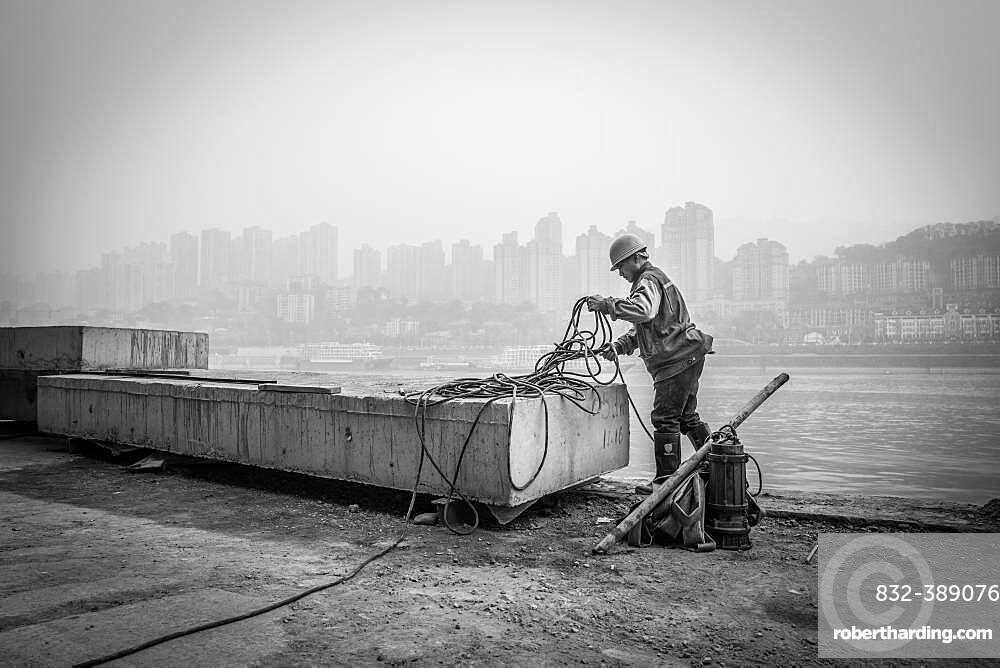Construction workers on the banks of the Yangtze River, Chongqing Port, Chongqing, China, Asia