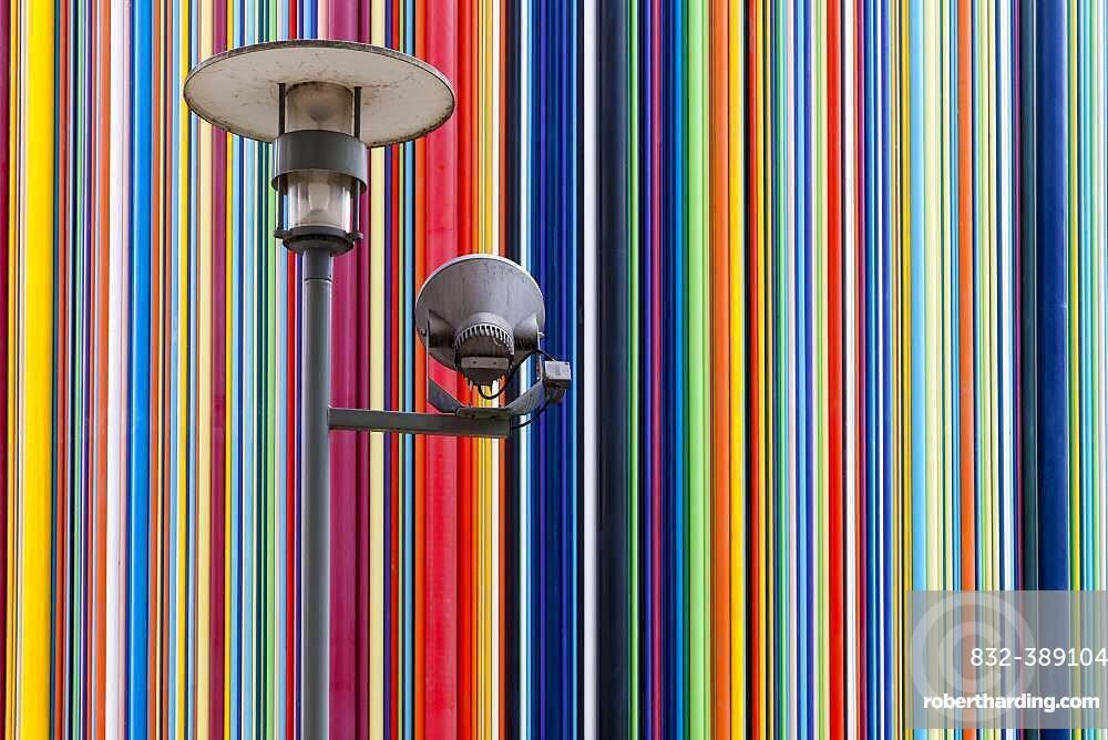 Colourful striped sculpture and street lamp, la Defense, Paris, France, Europe