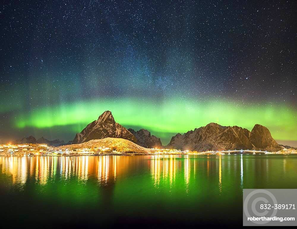 Northern lights at the fjord above the fishing village Reine, Moskenes, Nordland, Lofoten, Norway, Europe