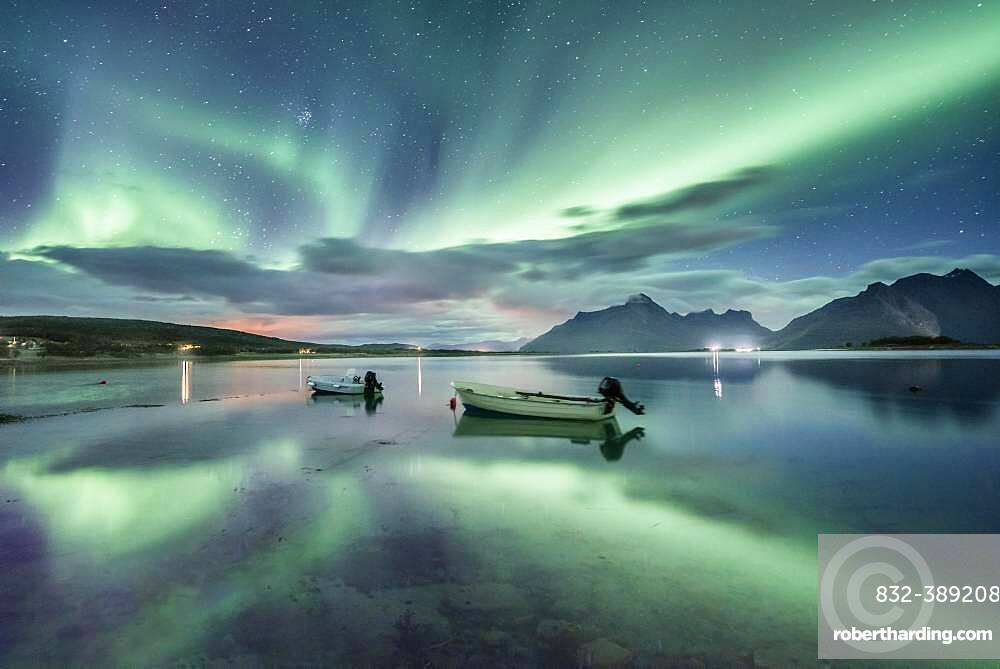 Small (Aurora borealis) motorboats anchoring in a bay, night view, starry sky, northern lights Northern Lights, Straumen, Nordland, Norway, Europe