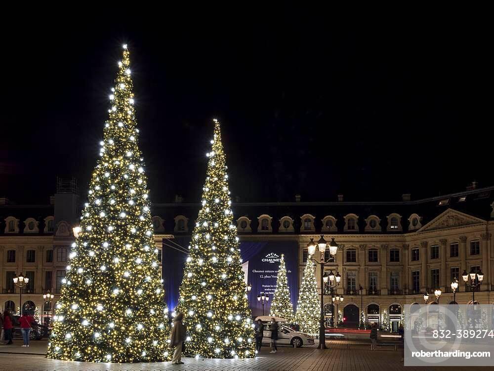 Night shot of illuminated Christmas trees at Place Vendome, Paris, France, Europe