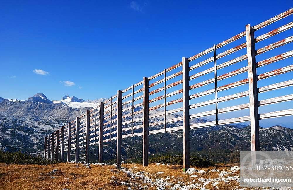 Avalanche barrier with view to the Hoher Dachstein, Dachstein massif, Krippenstein, Obertraun, Salzkammergut, Upper Austria, Austria, Europe