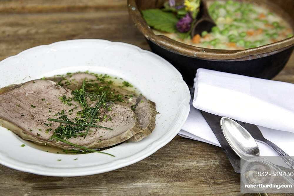 Boiled boiled beef with beef soup and chives, peas and carrots as creamy vegetables, Rauris, Pinzgau, Salzburger Land, Austria, Europe