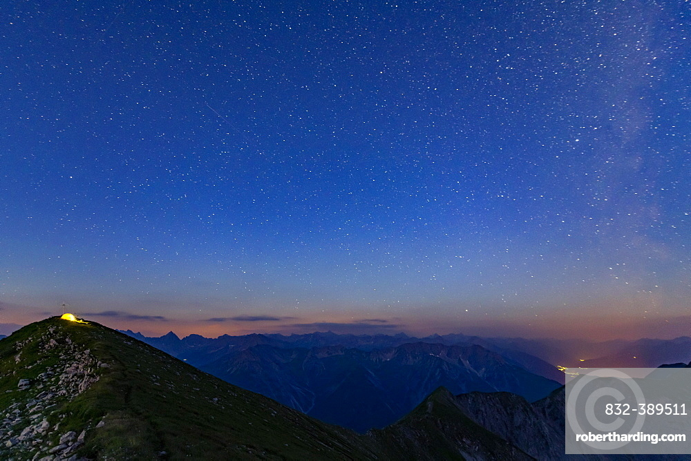Starry sky summit of Kreuzspitze and tent, Lechtal Alps in the background, Elmen, Lechtal Alps, Ausserfern, Tyrol, Austria, Europe