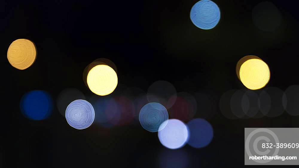 Abstract dark background with sparkling yellow and blue lights, Barcelona, Spain, Europe