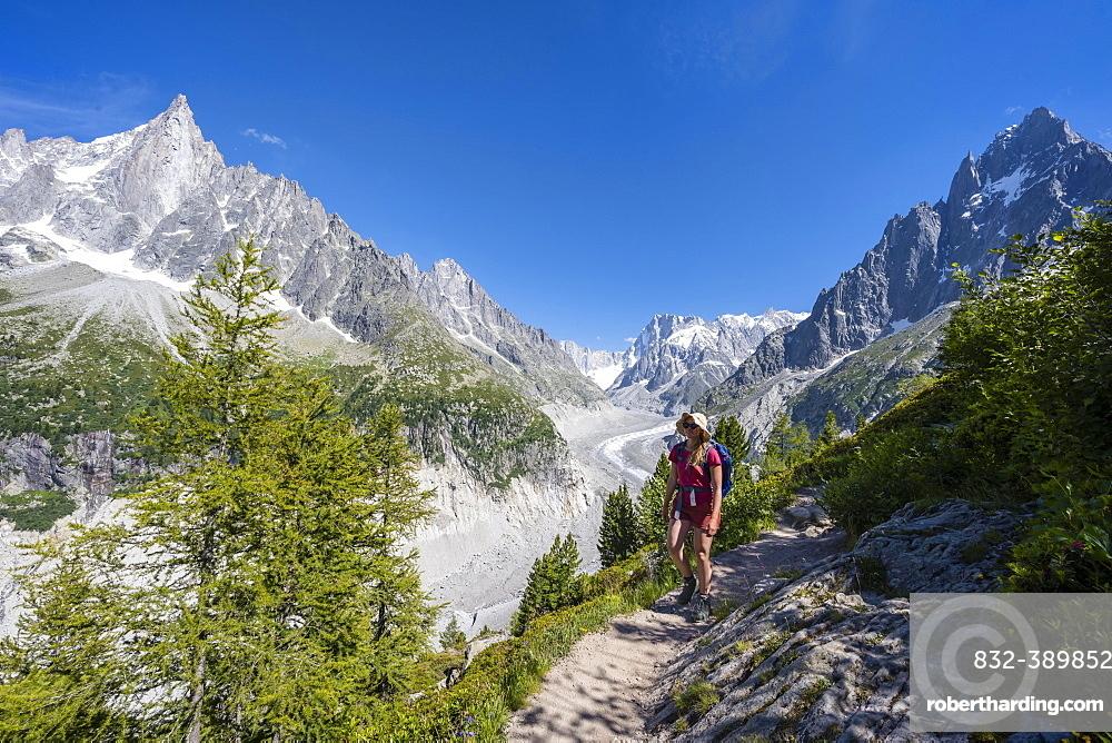 Climber on hiking trail, Grand Balcon Nord, glacier tongue Mer de Glace, behind Grandes Jorasses, Mont Blanc massif, Chamonix, France, Europe