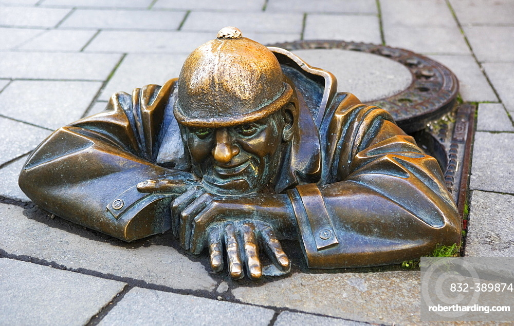 Bronze sculpture The Gaffer in the pedestrian zone, male figure looking out of manhole, Bratislava, Slovakia, Europe