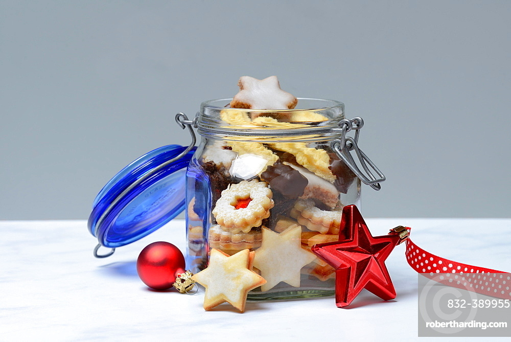 Glass container with Christmas cookies, Germany, Europe
