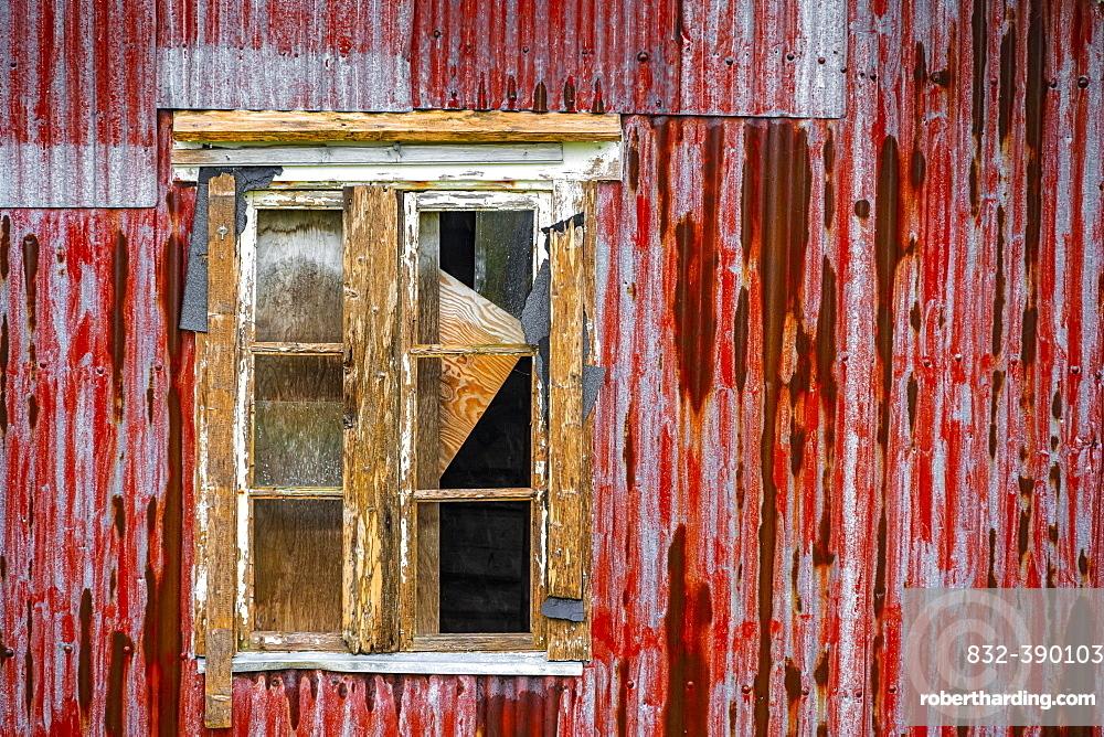Broken window of a dilapidated wooden house, Lofoten, Norway, Norway, Europe