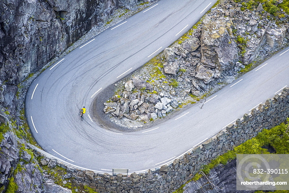 Single cyclist, hairpin bend at the mountain road Trollstigen, near Andalsnes, More og Romsdal, Vestland, Norway, Europe