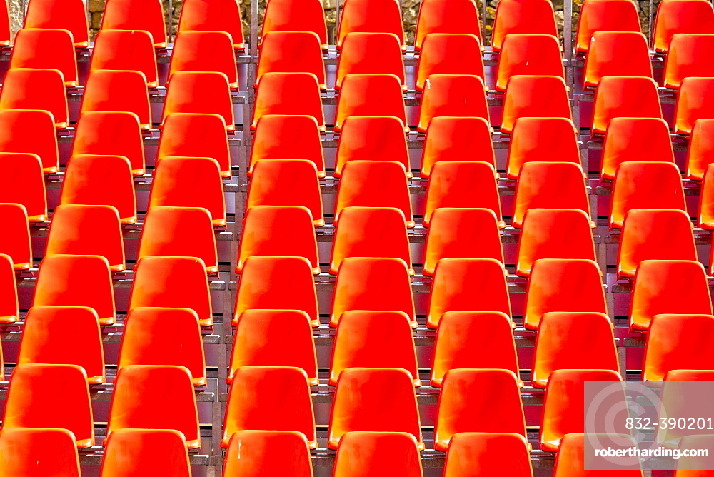 Rows of red empty chairs, France, Europe