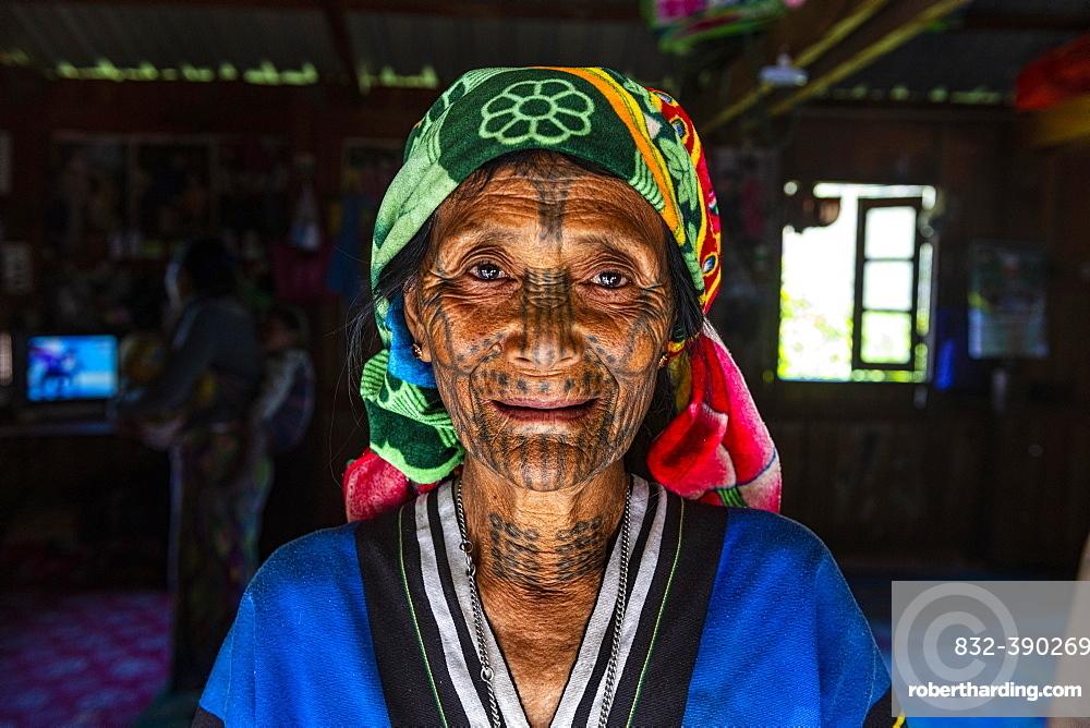 Chin woman with spiderweb tattoo, Mindat, Chin state, Myanmar, Asia