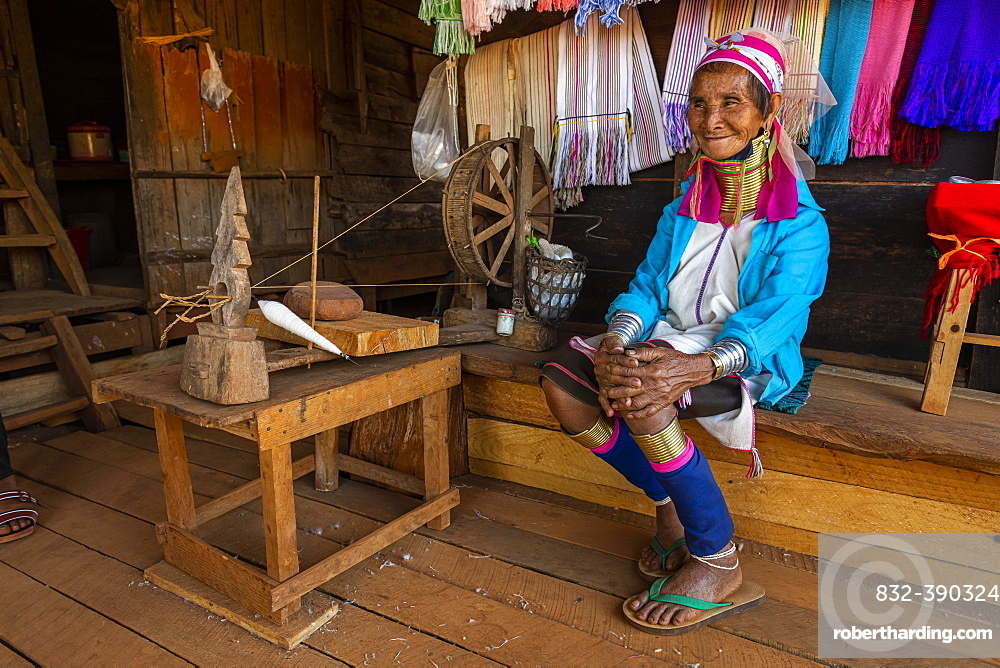 Portrait of a Padaung, giraffe with a traditional weaving chair, woman, Loikaw area, Kayah state, Myanmar, Asia