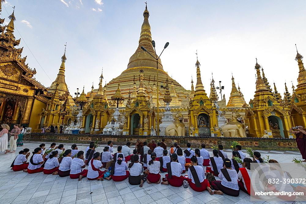 Pilgrims praying in the Shwedagon pagoda, Yangon, Myanmar, Asia