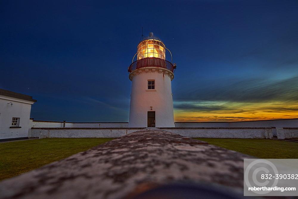 St. John`s Point lighthouse at dusk, with luminous light on, St. John`s Point, County Donegal, Ireland, Europe