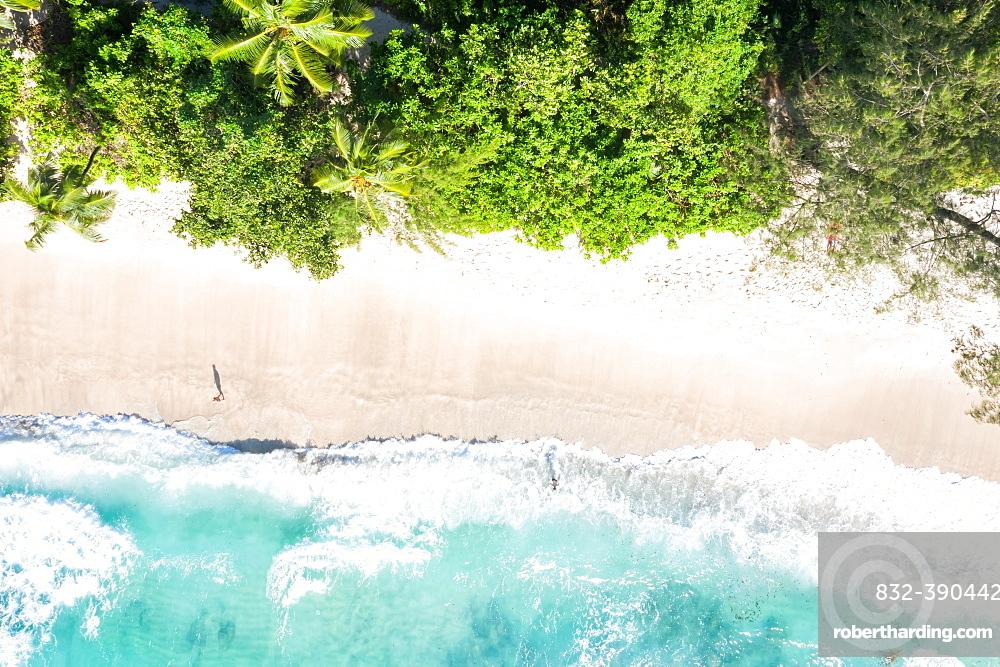 Takamaka beach sea holiday waves ocean drone shot bird's eye view, Mahe, Seychelles, Africa