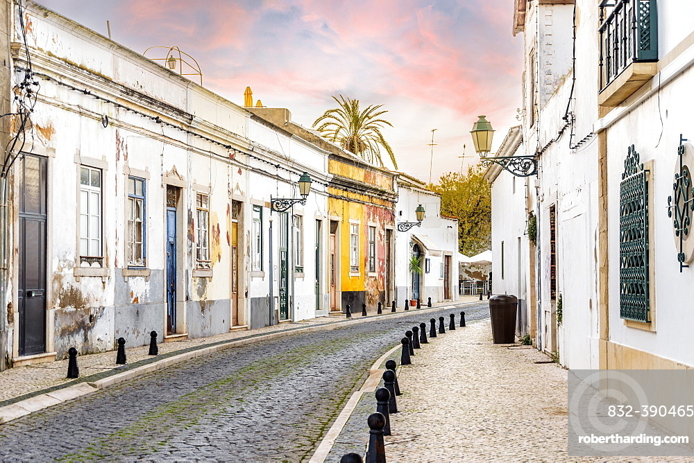 Traditional old Portuguese houses in old town of Faro by sunset, Algarve, Portugal, Europe