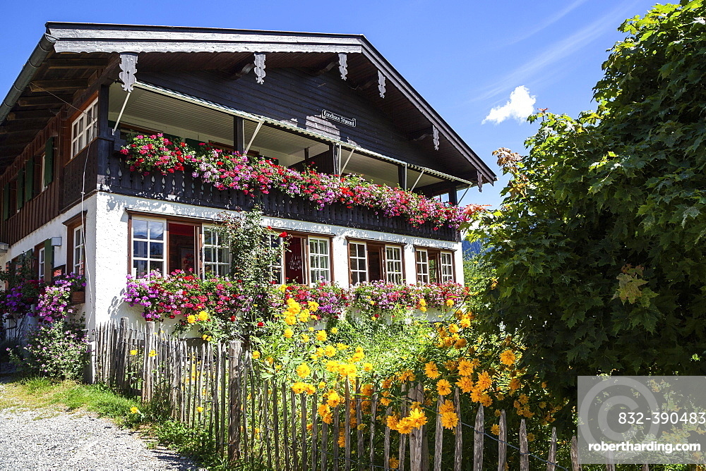 Old farmhouse with farm garden in Schwand, near Oberstdorf, Oberallgaeu, Allgaeu, Bavaria, Germany, Europe
