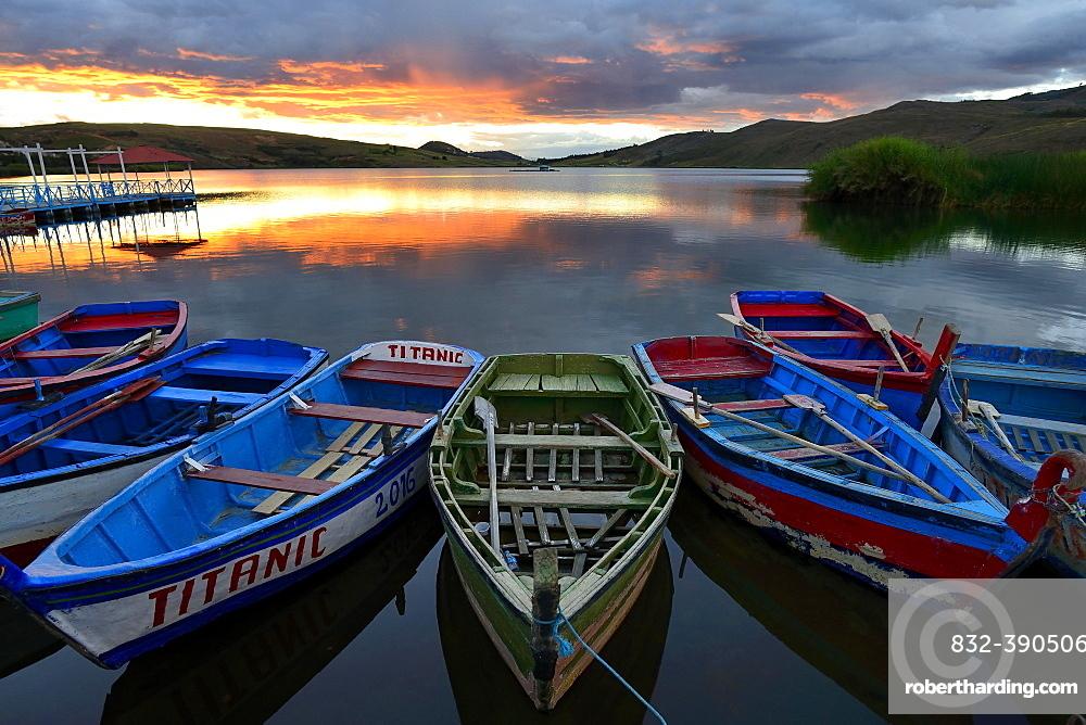 Rowboats on Laguna Sausacocha at sunset, Huamachuco, Sanchez Carrion Province, Peru, South America
