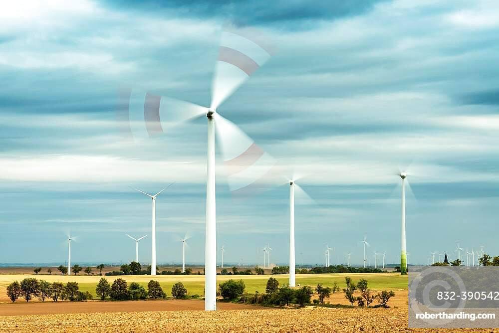 Field landscape with rotating wind turbines, Saalekreis, Saxony-Anhalt, Germany, Europe
