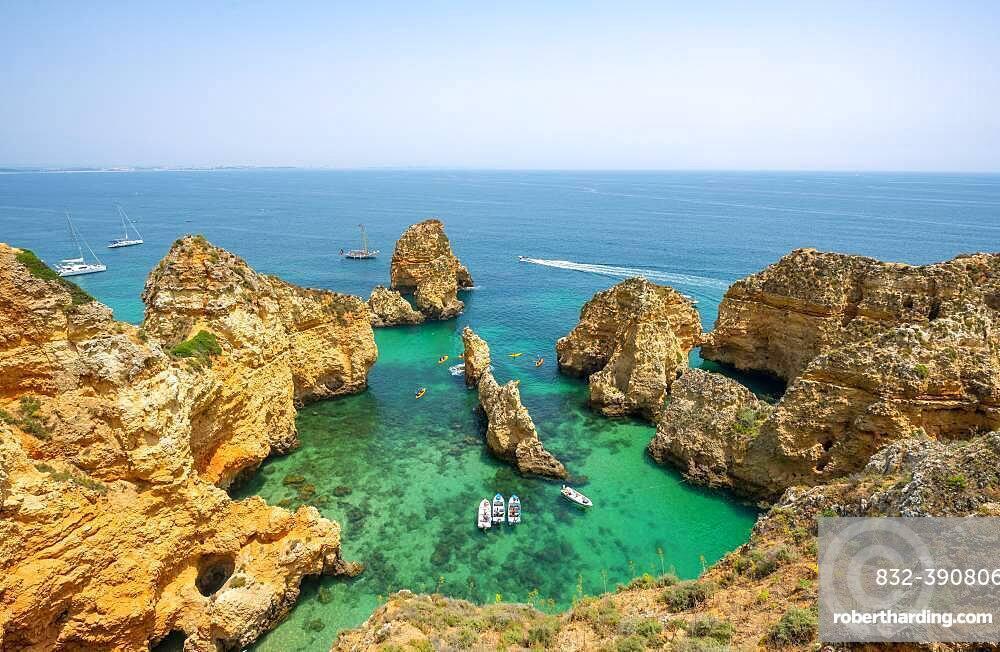 Rugged rocky coast with cliffs of sandstone, rock formations in the sea, Ponta da Piedade, Algarve, Lagos, Portugal, Europe