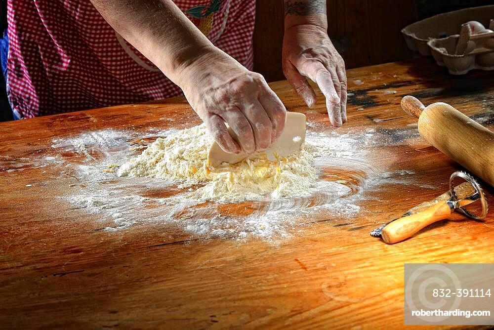 Woman mixes fresh pasta dough, Germany, Europe