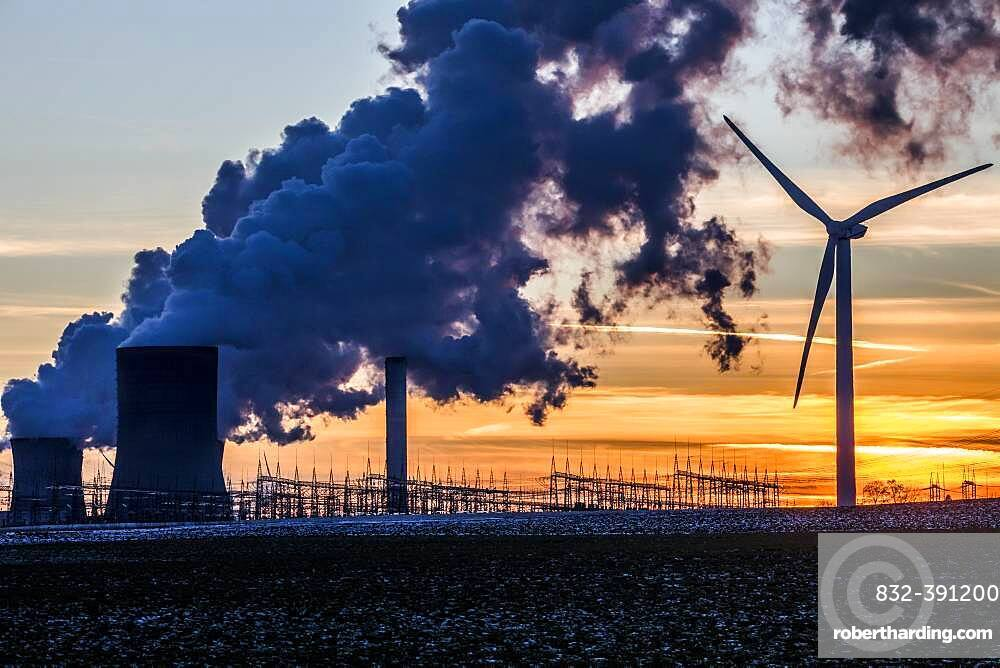 Wind turbine in front of steaming coal-fired power plant at sunset, energy transition, fossil and renewable energy, Niederaussem, North Rhine-Westphalia, Germany, Europe