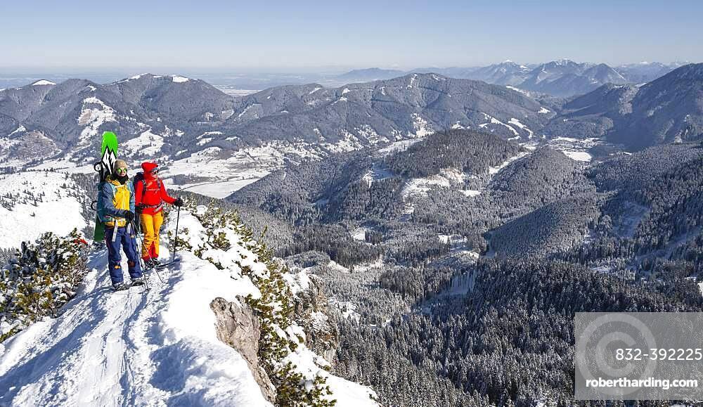 Young woman and man on ski tour, ski tourers on tour to Teufelstaettkopf, Ammergau Alps, Unterammergau, Bavaria, Germany, Europe