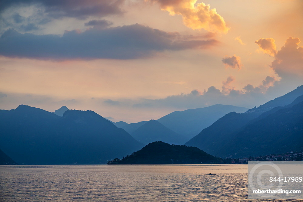 View of solitary rowing boat on Lake Como at sunset, Province of Como, Lake Como, Lombardy, Italian Lakes, Italy, Europe