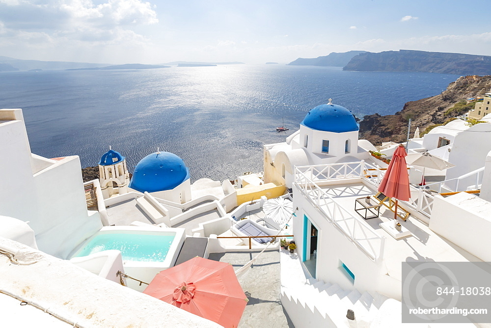 View of blue domed churches from cafe in Oia village, Santorini, Cyclades, Aegean Islands, Greek Islands, Greece, Europe