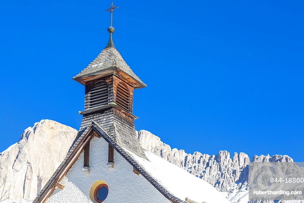 Church by mountains in Carezza, Italy, Europe