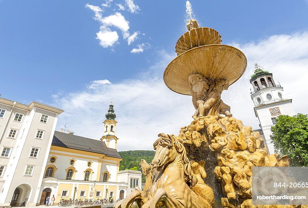 View of Baroque Fountain and Salzburger Glockenspiel in Residenzplatz, Salzburg, Austria, Europe
