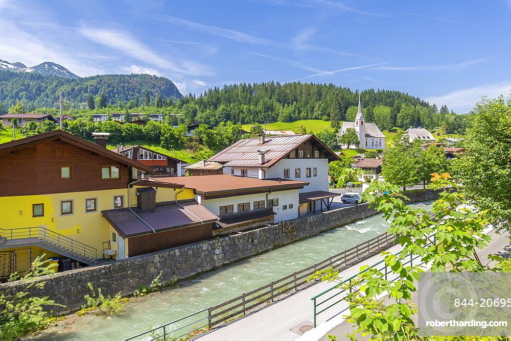 Elevated view of river through Fieberbrunn, Fieberbrunn, Austrian Alps, Tyrol, Austria, Europe