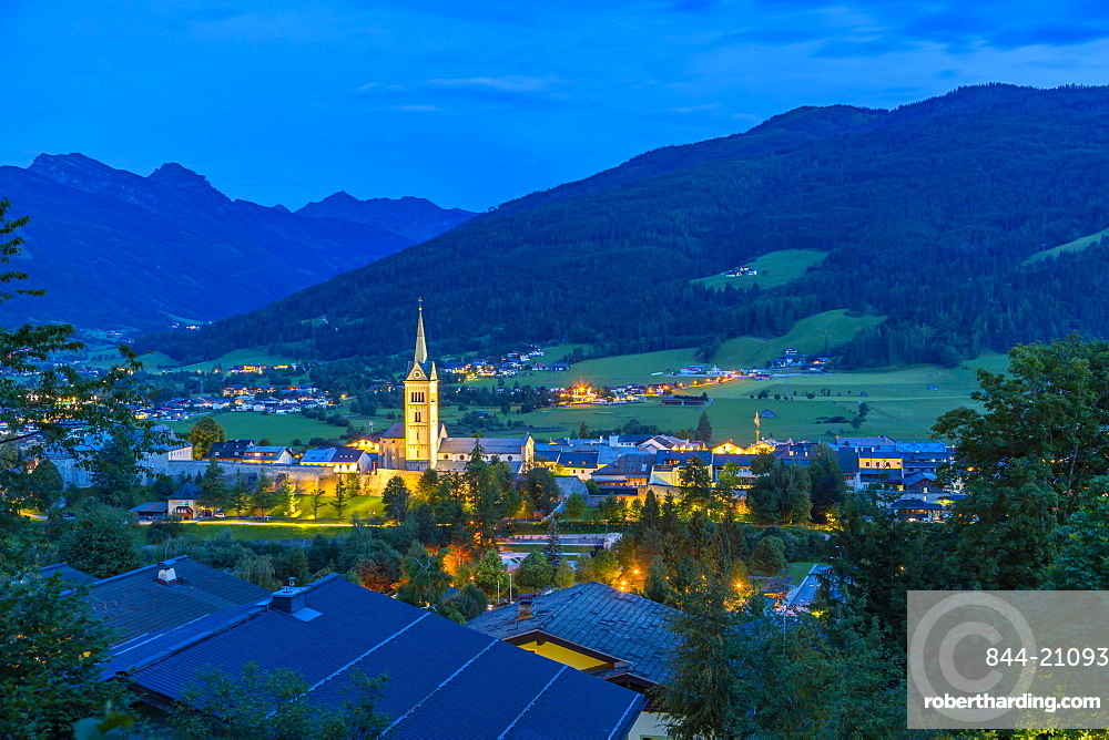 View of illuminated church in Radstadt at dusk, Radstadt, Styria, Austria, Europe