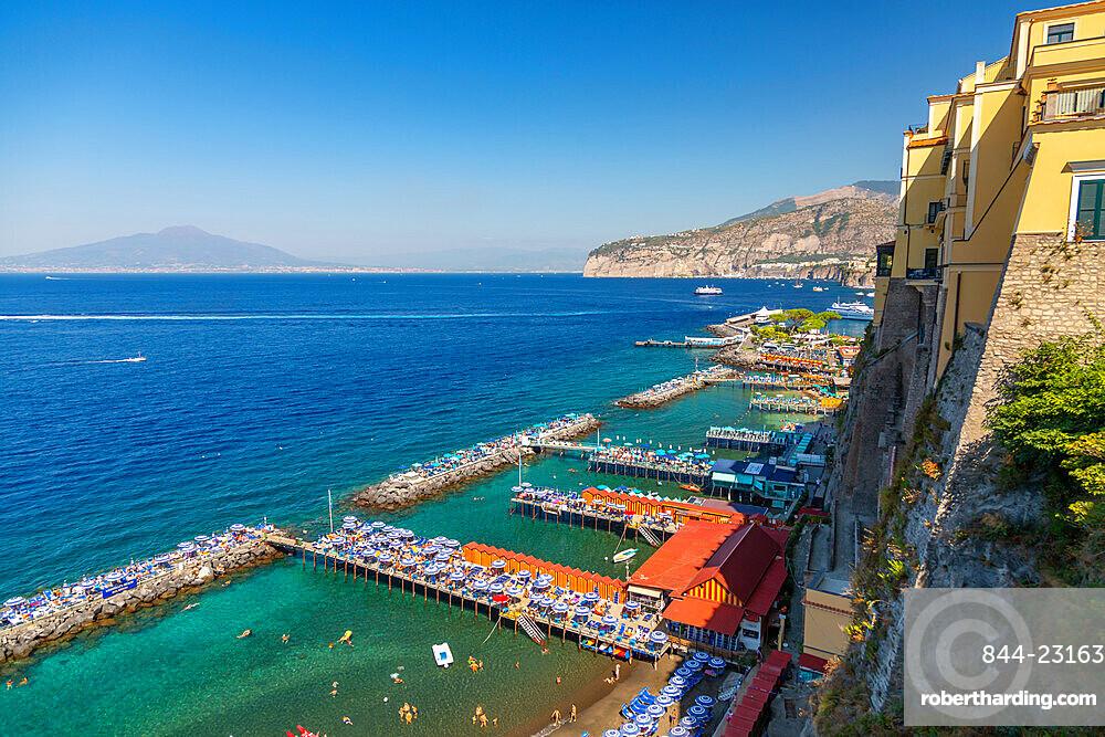 View of Leonelli's beach, public beach and Mount Vesuvius, Sorrento, Campania, Italy, Europe
