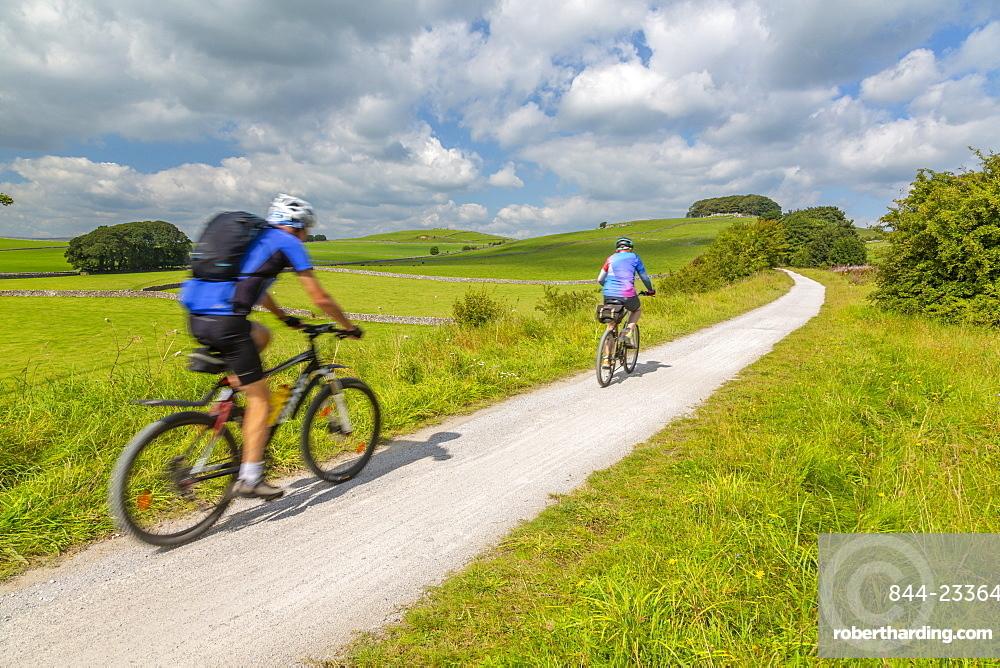 View of cyclist on the Tissington Trail, Tissington, Peak District National Park, Derbyshire, England, United Kingdom, Europe