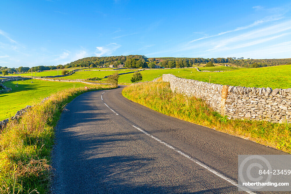 View of dry stone walls on country lane, Foolow, Derbyshire Peak District, England, United Kingdom, Europe