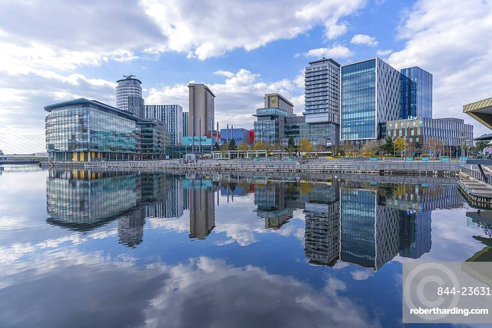 View of Media City and clouds reflecting in water in Salford Quays, Manchester, England, United Kingdom, Europe