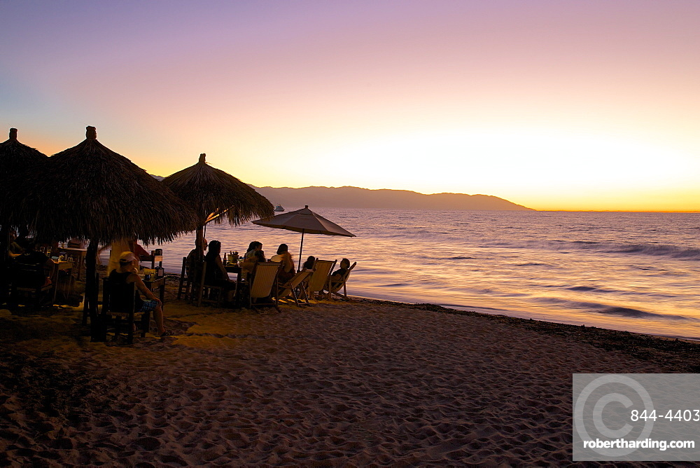 View over beach at dusk, Downtown, Puerto Vallarta, Jalisco, Mexico, North America