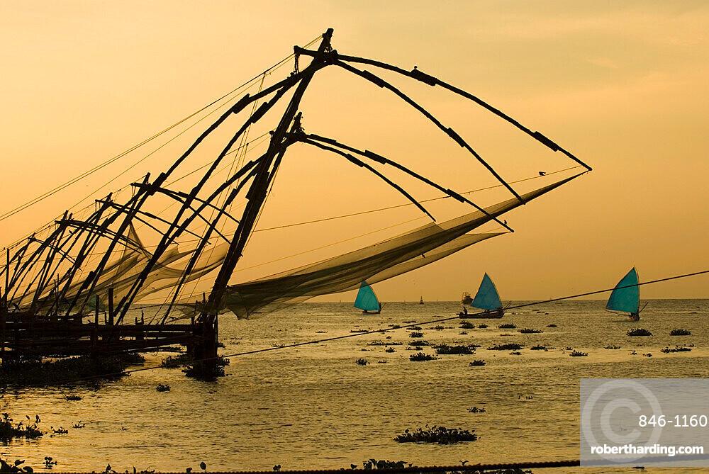 Chinese fishing nets at sunset, Kochi (Cochin), Kerala, India, Asia