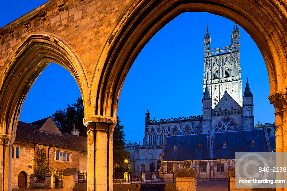 Gloucester Cathedral viewed through the Infirmary Arches at night, Gloucester, Gloucestershire, England, United Kingdom, Europe